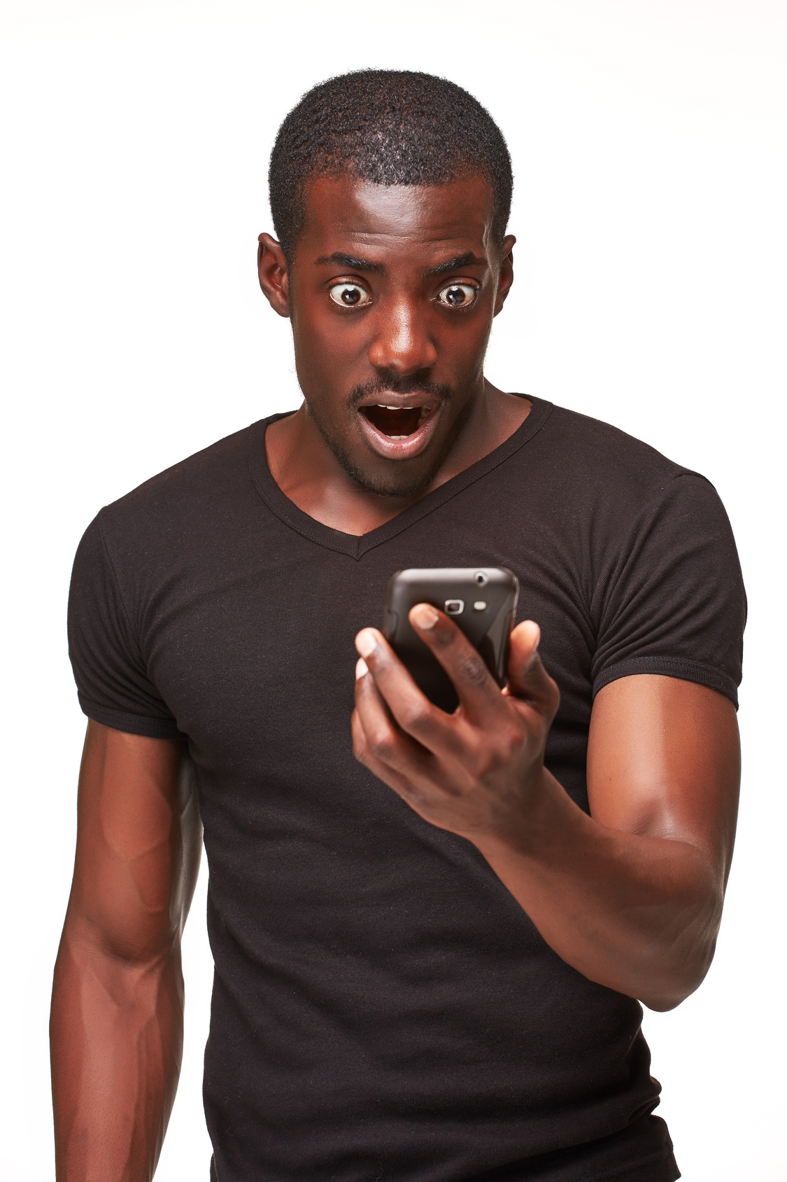 Portrait of surprised african man talking on the phone isolated on a white background